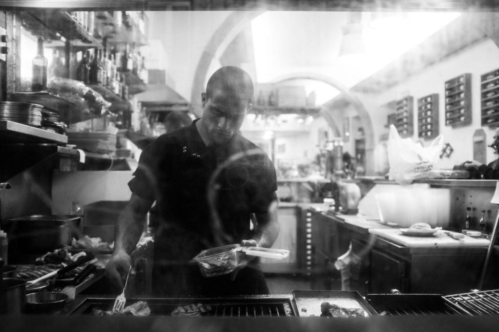 Window shot of a restaurant. The Fujifilm X100F is so discreet that this guy didn't even spot that I was taking him a picture.