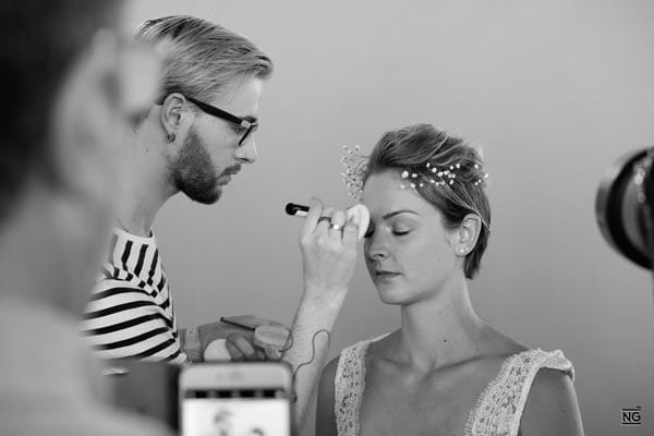 - touching up the model's makeup during the beauty photoshoot and a quick browse through the photos on the back of theFujifilm GFX 50s.